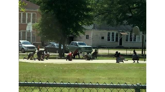 Kids playing basketball stop to kneel for Louisiana funeral procession