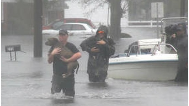 Rescuers rush to save people and pets from rising North Carolina flooding