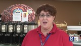 Cathy Kolb brightens up workers' days with song while working a cash register